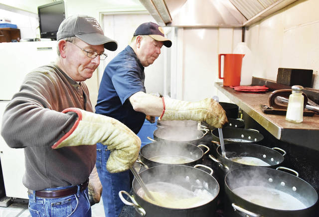 Wally Meyer, left, and his brother Mike Meyer, both of Newport, stir cooking spaghetti at The Newport Sportsmen Club's 28th annual spaghetti dinner to benefit Wilson Hospice of the Wilson Memorial Hospital on Sunday, Feb. 9. A line wrapped all the way to the back wall of the The Newport Sportsmen Club as people waited to eat.