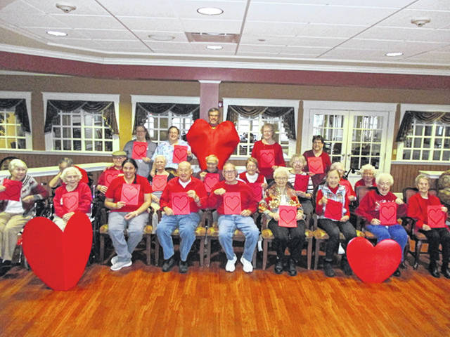 Residents at Elmwood Assisted Living gathered to take a photograph for the American Heart Association in time for February's National Heart Month.