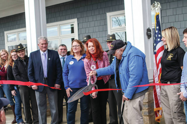 The ribbon is cut at the new Bob Sargeant & Family Shelby County Animal Shelter & Adoption Center during its ribbon cutting ceremony on Sunday, Nov. 10, 2019.