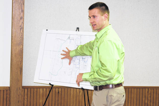Ryan Lefeld, of Choice One Engineering in Sidney, explains details of a storm water study to members of Jackson Center Village Council. The study was initiated after the mid-June 2019 flood that caused millions of dollars of damage to the village and surrounding area. Council is looking into options to help prevent a similar situation in the future should heavier than normal rainfall occur.