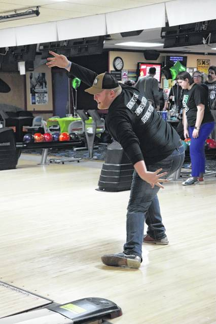 Big Brothers Big Sisters board member Maverick Long, of Anna, bowls a strike at the 2019 Bowling for Kid's Sake fundraiser.