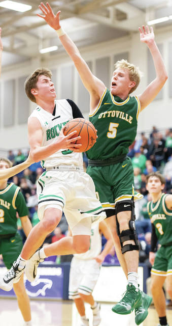 Anna senior guard Isaac Lininger shoots with pressure from Ottoville's Ryan Suever during the first half of a game in Flyin' to the Hoop on Jan. 20 at Trent Arena in Kettering. Anna was voted the No. 1 seed in the 24-team Dayton Div. I sectional.