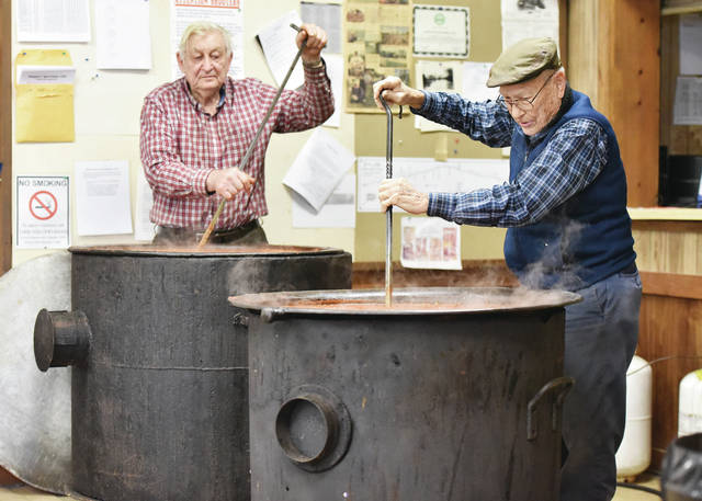 Conrad Phlipot, left, of Russia, and Calvin McCorkle, of Fort Laramie, stir two vats of spaghetti sauce at the Newport Sportsmen Club on Sunday, Feb. 2. The sauce will be used during the 28th annual spaghetti dinner to benefit Wilson Hospice of the Wilson Memorial Hospital on Feb. 9, 2020.