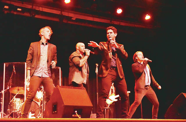 The Company Men, hosted by the Gateway Arts Council, performs at the Sidney High School on Sunday, Feb. 9. The band sings mash ups of todays top 40 hits with classics of the last 60 years.
