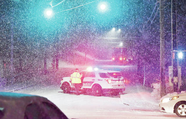 Sidney police closed off the hill on the 700 block of East Court Street when vehicles began struggling to make it to the top after snow made it icy on the evening of Wednesday, Feb. 12.