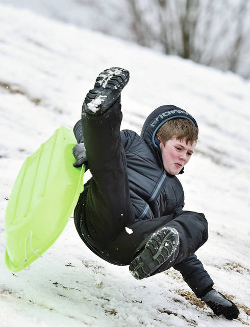 Alex Goubeaux, 11, of Sidney, son of Kyle and Emily Goubeaux, flies through the air after going over a bump while sledding at the Moose Golf Course on Thursday, Feb. 13.