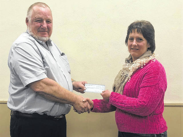 Midwest Electric Community Connection Fund board member Robert Gaberdiel presents a $3,000 check to Terri Metzer for Auglaize County Horseman's Association. The funds will be used to improve the horse arena at Auglaize County Fairgrounds.