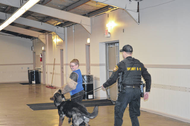 Shelby County Deputy Rod Robbins and his K-9 partner, Yago, demonstrate some of Yago's skills during a Dog Gone 4-H Club meeting.