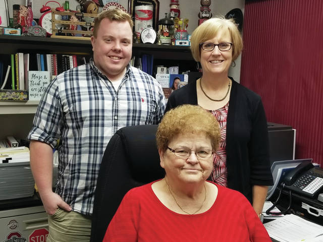 Betty Schulze, sitting, is assisted by her grandson, Ben Montgomery, and her daughter, Marcia Montgomery, at Schulze Accounting & Tax Service.