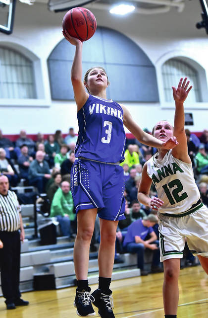 Miami East's Paxton Hunley shoots with pressure from Anna's Michaela Ambos during a Division III district semifinal on Monday in Covington.