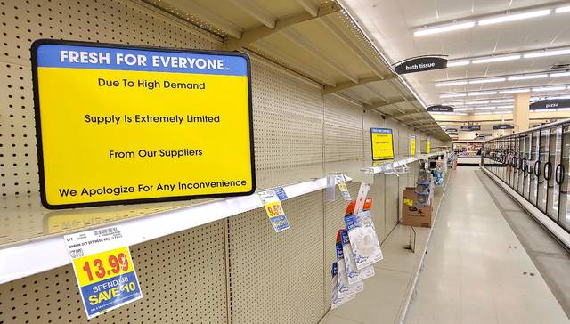A view of the bath tissue and paper towel aisle at Kroger on Michigan Street in Sidney on Sunday. Both items have been in high demand in the last several days due to people stocking up as a result of the coronavirus COVID-19 pandemic. Store employees told customers they can barely keep any such product on the shelves; whatever supply was put out for sale over the weekend was usually gone within 20 minutes of being stocked. Kroger, Wal-Mart and other national chains announced on Saturday they were going to utilize limited hours starting Sunday in an effort to disinfect stores and restock items.
