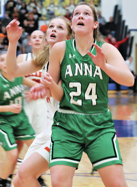 Anna senior forward Kiplyn Rowland fights for a rebound with Arcanum's Taylor Gray during a Division III district final on Saturday at Springfield High School. Rowland scored seven points.