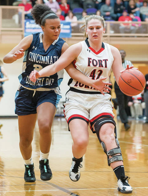 Fort Loramie senior forward Marissa Meiring dribbles with pressure from Cincinnati Country Day's Jada Moorman during a Division IV district final on Saturday at Vandalia-Butler's Student Activity Center. Meiring averages 10.1 points per game.