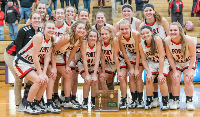 Fort Loramie players pose for a team photo shortly after receiving a Division IV regional championship trophy after a victory over Cincinnati Country Day on Saturday at Vandalia-Butler's Student Activity Center.