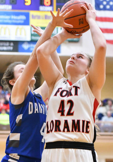 Fort Loramie senior forward Marissa Meiring shoots with pressure from Danville's Alenah Boeshart during the first half of a Division IV regional semifinal on March 5 at Vandalia-Butler's Student Activity Center. Meiring is one of four seniors for the undefeated Redskins, which may never get a chance to play for a state title following the OHSAA suspending tournament play.