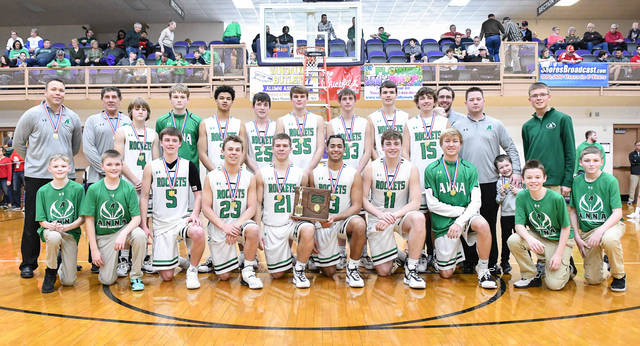 Anna players and coaches pose for a team photo after the squad beat National Trail in a Division III district final on Saturday at Vandalia-Butler's Student Activity Center.