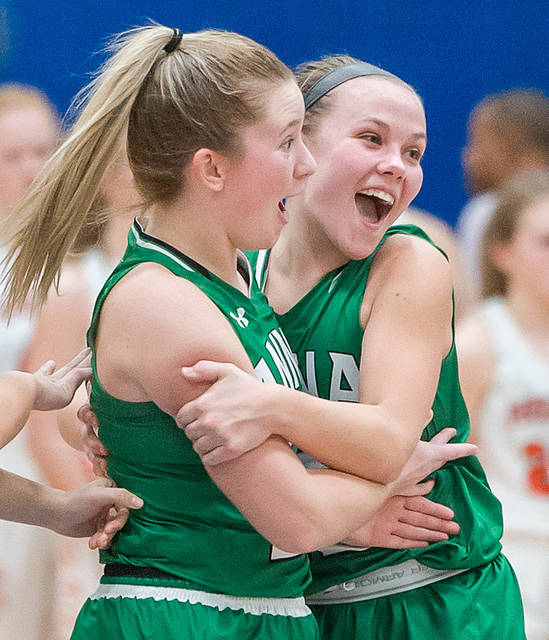 Anna senior guard Michaela Ambos, right, celebrates with senior forward Kiplyn Rowland following the Rockets' regional semifinal win over Versailles on Wednesday in Springfield. The Rockets will face Cincinnati Purcell Marian in a regional final on Saturday in Springfield.