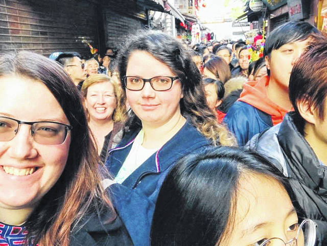 Sarah Bellmer, left, is pictured with her sister, Amy Bellmer. Between them is Amy Bellmer's coworker, Phyllis Berg. The streets of Shanghai, which normally are very busy, now seem deserted, Sarah Bellmer said, because of coronavirus fears.