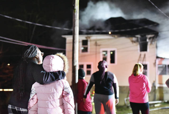 People watch the house fire.