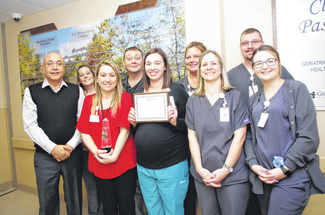 The Clear Passage Geriatric Psychiatric Center at Joint Township District Memorial Hospital recently was honored with the Horizon Health's 2018 Mental Health Outcomes award. Pictured, left to right, are Dr. Amarjeet Birdi, Tiffany Fishbaugh, Jody Shaw, Charles King, Stephanie German, Karen Raines, Angela Smith, Aaron Winget and Katelyn Koch.
