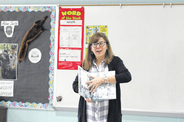 Local author Michelle Houts talks to students in fourth through sixth grade about the work that goes into illustrated stories at Botkins Local Schools. Houts visited students in kindergarten through sixth grade on Wednesday as part of Botkins Local Schools' Right to Read week.