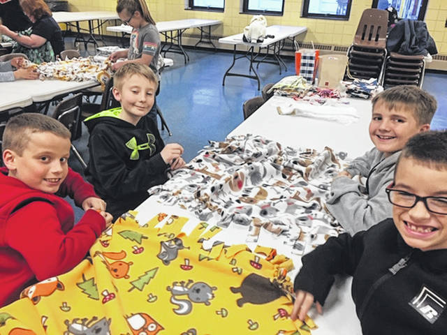Holy Angels Parish School of Religion third- through fifth-graders made blankets for the Wilson Hospital Pediatric Unit and to tornado victims in Nashville for a service project.
