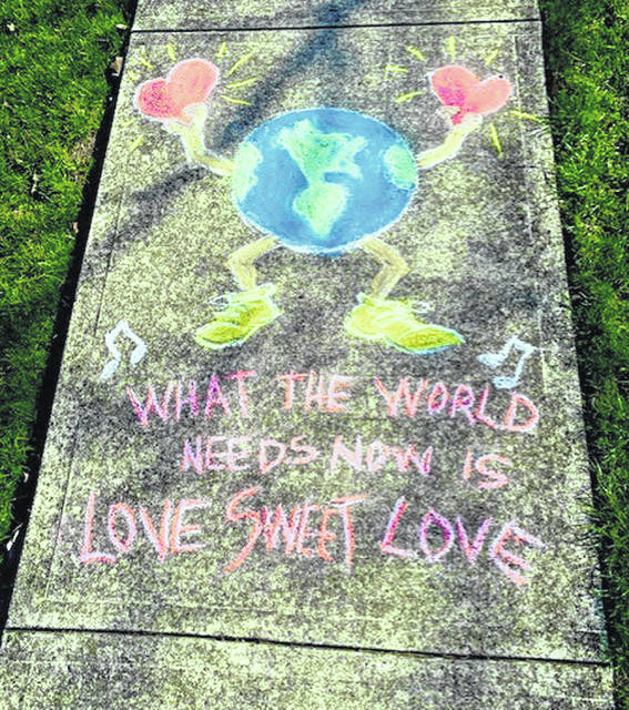 "John Dunlap, of Sidney, created this sidewalk design, which shares the feelings of Americans during the coronavirus (COVID-19) pandemic: ""What the World needs now is love, sweet love."""