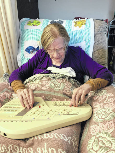 Lenetia Shoemaker plays her old omnichord as part of music therapy through Ohio Hospice of Miami County.