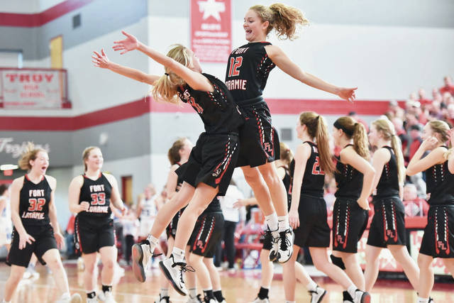 Fort Loramie's Caitlyn Gasson, left, and Kennedi Gephart celebrate after defeating Franklin-Monroe in a Division IV district final on Saturday at the Trojan Activities Center in Troy.