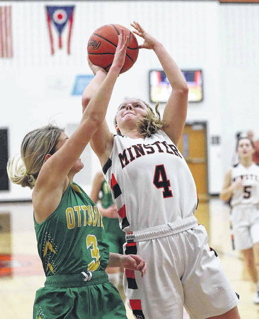 Minster junior guard Ivy Wolf shoots with pressure from Ottoville's Tori Thomas during the second quarter of a nonconference game on Jan. 18 in Minster. Wolf was named first team all-Northwest district in Division IV.