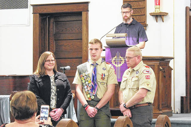 R.J. Poeppelman, front center, had his Eagle Court of Honor March 14 at St Lutheran Church in Botkins. He is standing with his parents, Linda and Scott Poeppelman, with Fred Schmerge in the background.