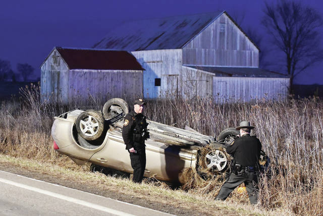 Shelby County Sheriff's Office deputies investigate a car that flipped upside down in a one vehicle accident on the 21000 block of State Route 47 near Maplewood shortly before 6:25 p.m. on Sunday, March 1. The driver was being evaluated by medics. responding to the scene were the Maplewood Fire Department and Perry Port Salem Rescue. Traffic was redirected around the stretch of State Route 47 involving the crash.