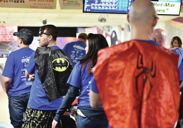 Matthew Schotte, left, dressed in a Batman cape while Cameron Eisenhardt, right, both of Sidney, dressed in a Spiderman cape while taking part in the Big Brothers Big Sisters Bowl For Kids Sake fundraiser at Bel-Mar Lanes on Saturday, March 7. Both men are on team Sidney Body CARSTAR.