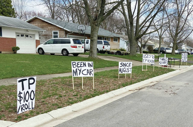 "Jackson Center Band Director Randy Johnson posted humorous signs in his front yard on Ruth Street in Sidney recently. The signs read ""TP $100/roll. Been in my car since August. Used to TP house. Thanks seniors. Kids free. Please take them."" The signs have since been taken down."