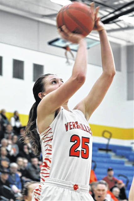 Versailles senior forward Lindsay Winner shoots during a Division III district final against Bethel-Tate on Saturday at Springfield High School.