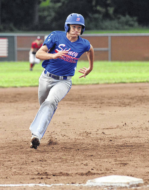 Sidney Post 217's Darren Hoying runs toward third base in a Region 2 tournament game on July 22, 2019 at Duke Park in Troy. Post 217 won the Region 2 tournament and earned its third state berth in four years.