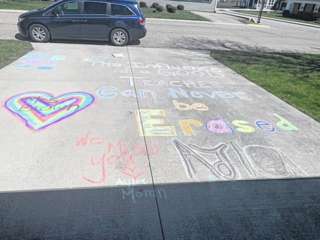 Twin sisters Andie and Ayla Moran spent their afternoon chalking messages outside their teachers homes on Thursday, April 2. Due to the stay at home orders in place to protect Ohioans from the coronavirus, the girls haven't been able to attend school and wanted to show their appreciation for their teachers.