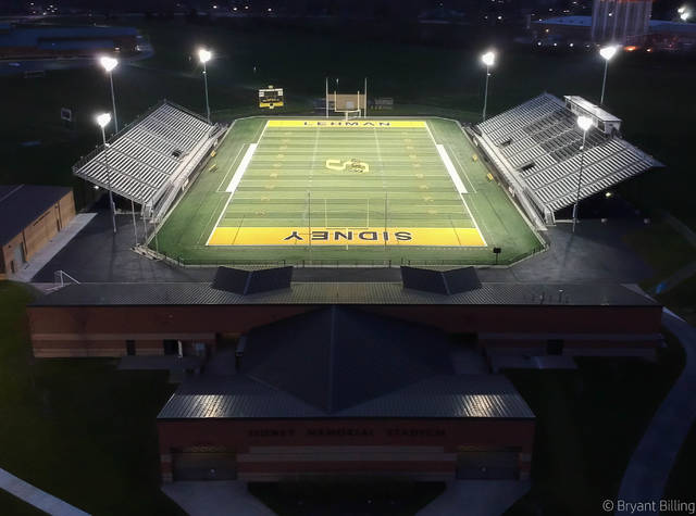 A view of Sidney Memorial Stadium on Monday night. The school and all other members of the Miami Valley League turned on lights at their stadiums in a symbolic event to honor seniors who have had their year cut short due to statewide school closures. Schools buildings in Ohio have been closed for over a month as a result of efforts to slow the spread COVID-19, and all sporting events and practices have been barred by the Ohio High School Athletic Association. The state extended school closures for the rest of the academic year on Monday, which will force the OHSAA to cancel spring sports. Similar symbolic light displays have been put on at schools around the country, including in Michigan and Pennsylvania last weekend. Many other schools in Ohio participated Monday night.