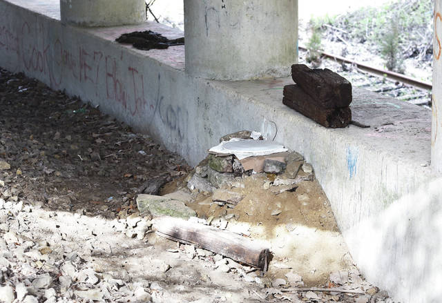 A makeshift toilet under the bridge.