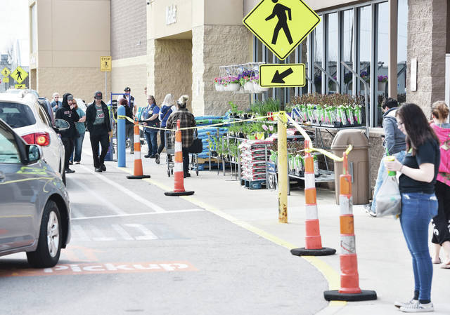Walmart began counting how many people are allowed into the store on Saturday, April 4. Tape was set-up to handle a line of people waiting to enter but once opened no one was made to wait as of early afternoon.
