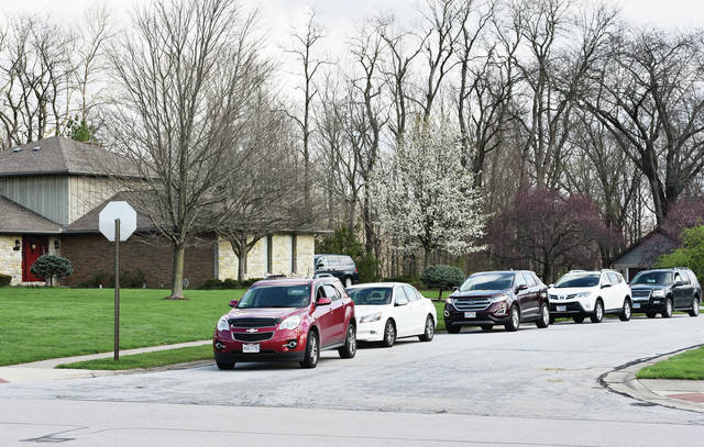 A line of 7-8 cars drives past the house of Pastor Michael Mitchell while honking on Thursday, April 9. The cars were doing the drive-by to celebrate the pastor's birthday. The house is located at 2401 Wells Road. Mitchell is the pastor at Maplewood United Methodist Church.
