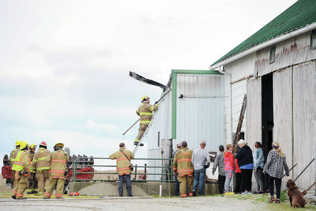 Russia and Fort Laramie firefighters make sure a barn fire is out at 847 Perin Road located north of Russia at 3:30 p.m. on Wednesday, April 29. The fire was quickly extinguished.