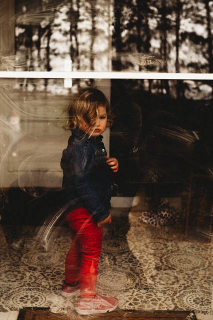 Bobbie DeBrito photographed 2-year-old Greta Fullenkamp, the daughter of Leah Fullenkamp, of Fort Loramie, in her home as part of the Front Porch Project. Greta is the daughter of the late John Fullenkamp.