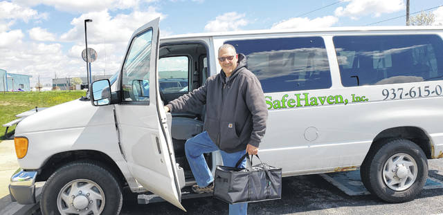 Bruce Kaufman, SafeHaven driver, is delivering food to area resdients.