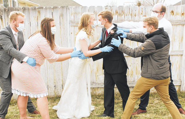 Members of the wedding party pose for a fun photo after the wedding. Pictured are, left to right, Corey and Sydney Saunders, Kathryn and Jacob Mumford, Tyler Mumford and Ryan Saunders.