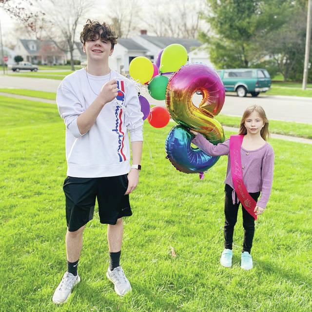 Carter Johnson-Young, left, son of Kelli Davis and Steve Young, who turns 14 on April 16, and Kenadee Davis, both of Sidney, daughter of Kelli Davis and Joshua Davis, who turned 8 on April 9, had a joint drive by birthday party on Saturday, April 11. The two children have been in isolation from friends, family, school and sports for 4 weeks to slow the spread of the Novel Coronavirus.
