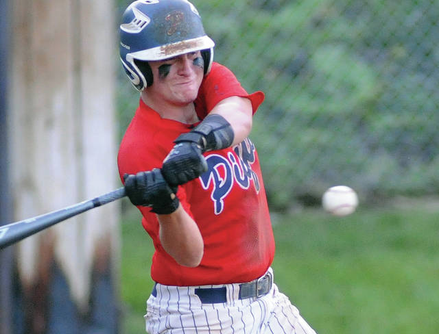 Piqua Post 184's Will Eversole, a Versailles graduate, makes contact during a game against Springfield Armaloy on Thursday at Hardman Field in Piqua. Many area baseball and softball players will be playing for squads around the region this summer after Gov. Mike DeWine's announcement earlier this month that those two sports could begin competition.