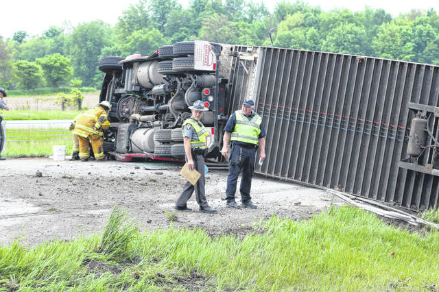 A state trooper looks at track marks at the scene of an accident involving an overturned semi blocking both southbound lanes on I-75, near mile marker 99 in Anna. The driver, William Howe Jr., sustained minor injuries and was treated on scene by Anna Rescue. Howe was cited with failure to control.