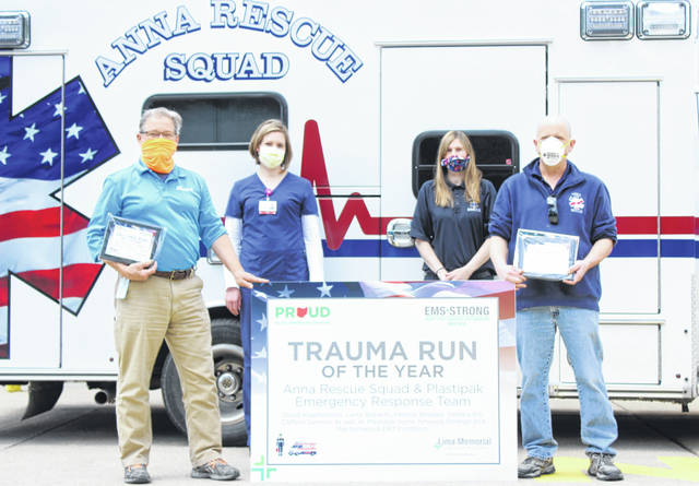 Plastipak EHS Manager Andy Slonkosky, Wilson Health Registered Nurse Amanda Schmerge, EMT Pamela Knapke of Anna Rescue, and EMT Clifford Damron of Anna Rescue were honored Thursday with Lima Memorial Hospital's Trauma Run of the Year Award for their combined effort in administering emergency first aid to a Plastipak employee.