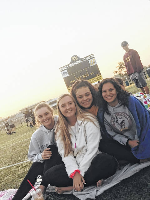 This picture was taken the day before we started our senior year. We all gathered at the stadium to watch the sunrise. The Class of 2020 sat on the football field, ate donuts, and talked about all the things we'd get to do this school year. Pictured are, left to right, Soleil Drinnen, Kaitlyn Van Zant, Ranaya Conrad and Aleyce Cunningham.